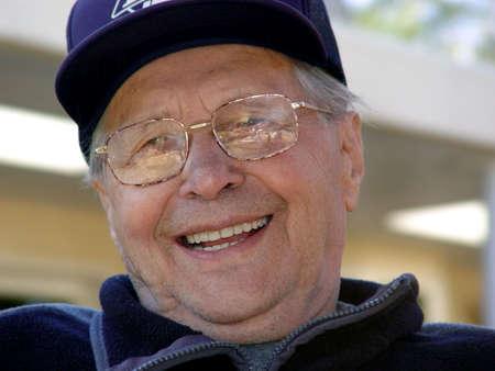 in loving memory: Smiling older man outdoor