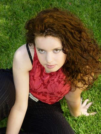 Beautiful girl sitting on the grass Stock Photo - 352706