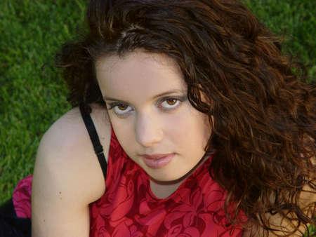 Beautiful girl sitting on the grass Stock Photo - 352705