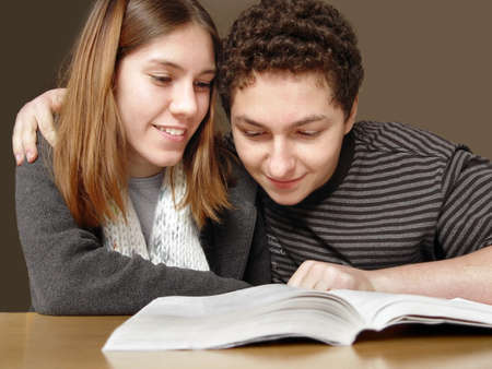 2 teenagers reading a book photo