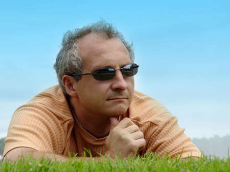 A man on the grass photo