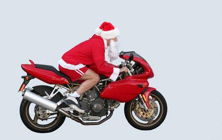 weihnachtsmann lustig: Santa Claus auf einem Motorrad in Kalifornien