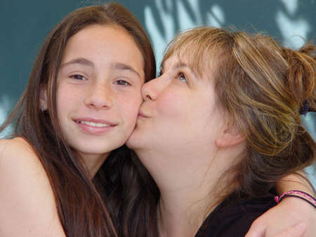 Mother kissing her daughter Stock Photo - 359396