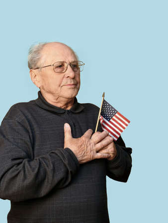 aging american: Senior man with american flag isolated