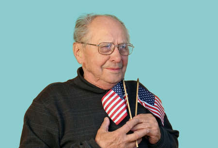 Senior man with american flag isolated photo