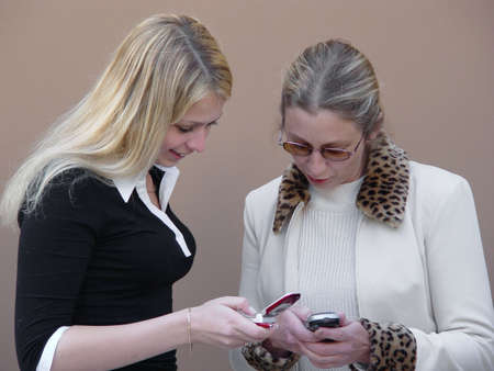 Blond women with phones photo