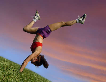 activewear: Girl exercising outdoors against sunset