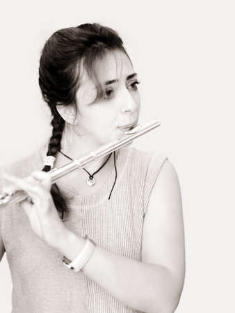 flute key: Beautiful woman playing flute