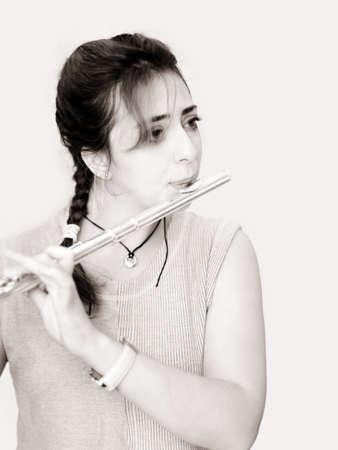 flute key: Beautiful woman playing flute