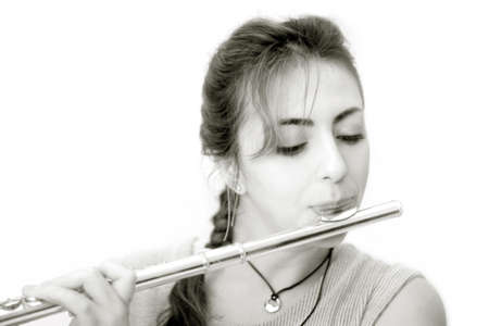 Beautiful woman playing flute photo