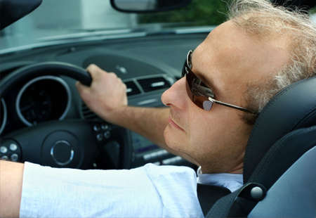 speedster: Mature man in the car Stock Photo