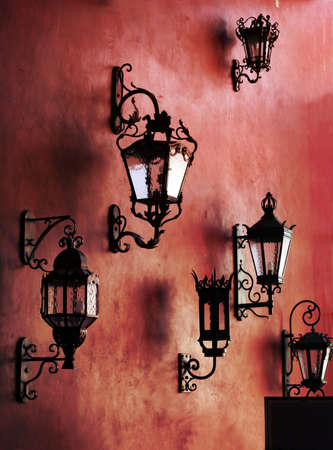 Red wall with lamps