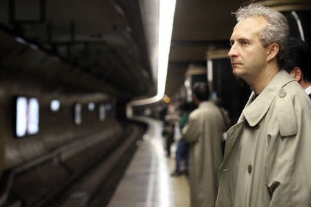 way of living: Man waiting for a train Stock Photo
