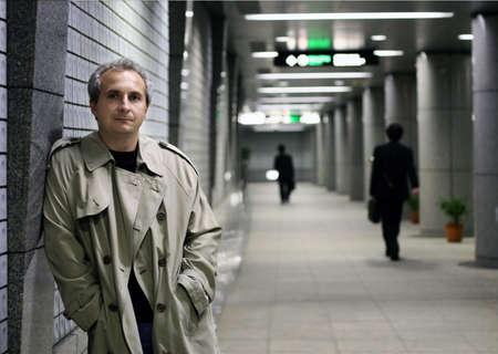 Man in subway at night photo