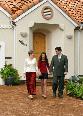 Happy family in front of their home Stock Photo - 386624