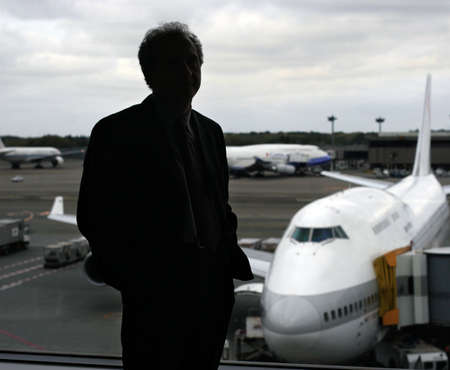 Businessman at the airport by the window Stock Photo - 386600