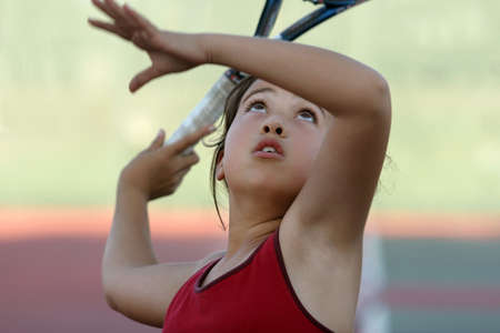 raquet: Young girl playing tennis Stock Photo