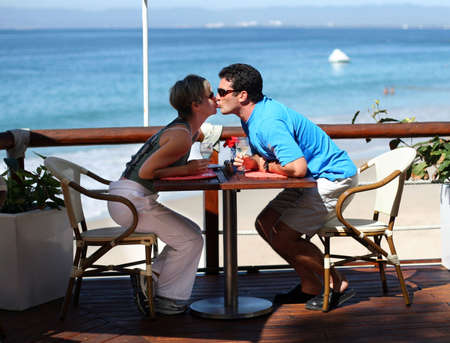 Kissing couple at a seaside cafe