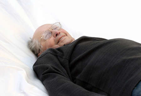 Old man in bed Stock Photo