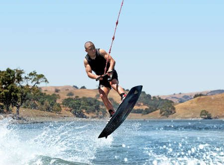 watersport: Boy Wakeboarding on the lake Stock Photo