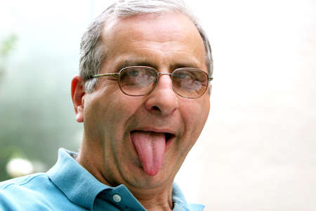 Mature man with his tongue out photo