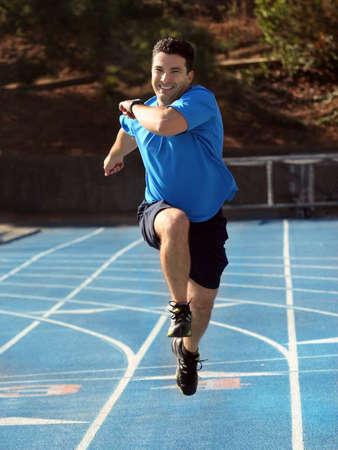 Man running on a blue racetrack