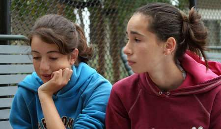 Two teenage girls discussing their problems outdoors Stock Photo - 555823