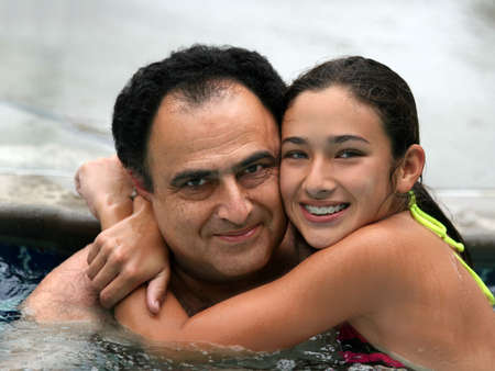 Father and daughter in the swimming pool Stock Photo