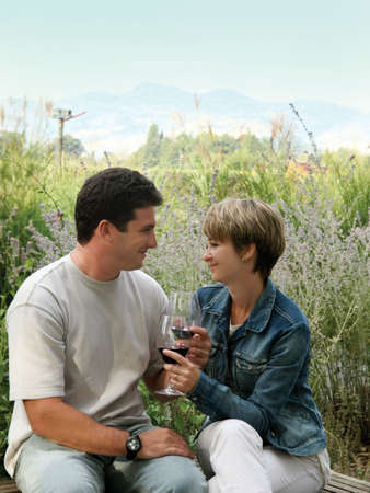 Young couple having picnic with wine photo