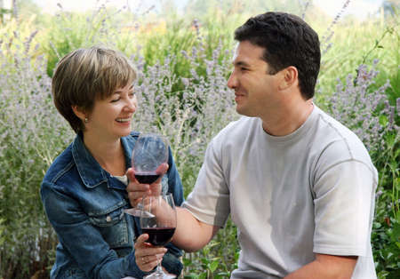 Young couple having picnic with wine