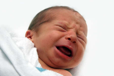 Crying baby on his first day photo