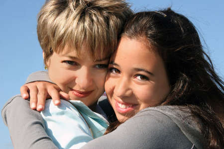 Cute girl hugging her mother on a sunny day Stock Photo - 562713
