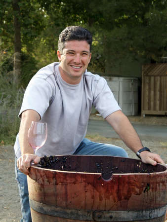 sonoma: Young man standing by the wooden barrel