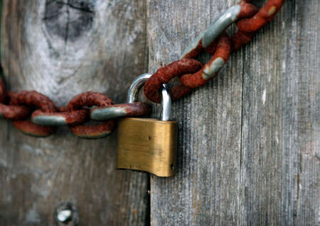 A lock and a rusty chain photo