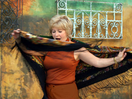 Happy senior woman with a scarf dancing Stock Photo - 601245