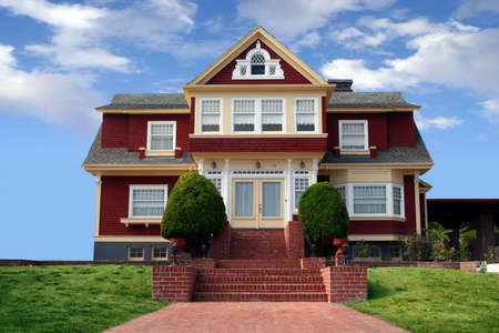 Beautiful red house with a lawn in front Stock Photo - 604986