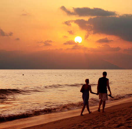 Couple walking on the beach at sunset Stock Photo - 637505