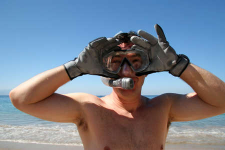 Man is about to go snorkeling in the ocean Stock Photo - 642691