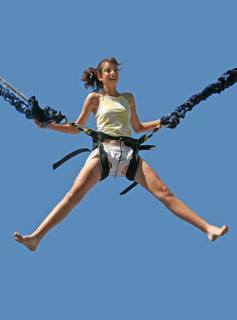 Girl having a good time bungee jumping