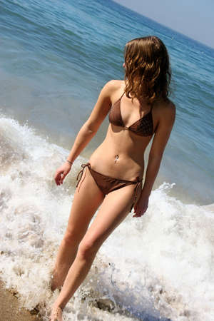 Bikini girl with her belly button pierced photo