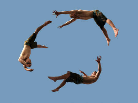 A cirlcle of three flying young athletic men