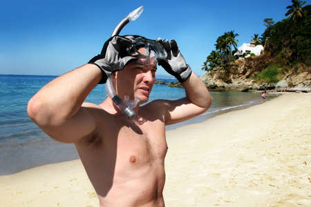 Man is about to go snorkeling in the ocean Stock Photo - 657110