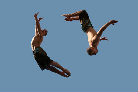 An image of two flying young athletic men