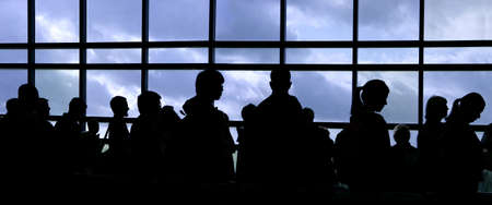 People waiting in line at the airport silhouette Stock Photo