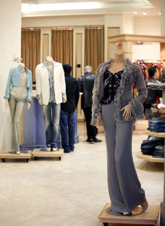 People and mannequins in a fancy department store Stock Photo