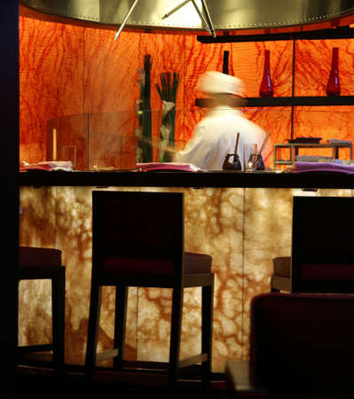Motion blurred cook in a modern style Japanese restaurant Stock Photo