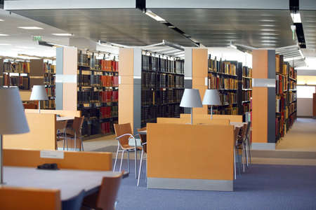 book racks: Tables and chairs in an empty library Stock Photo