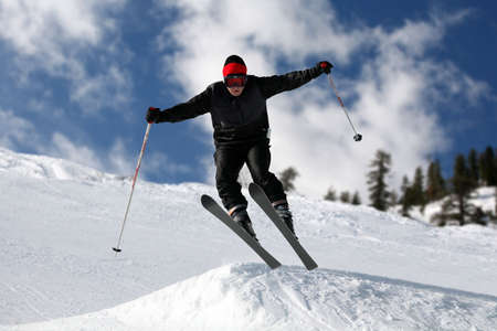 Skier on a slope against the cloudy sky Stock Photo