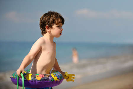 Little boy with toys on the beach Stock Photo - 747788