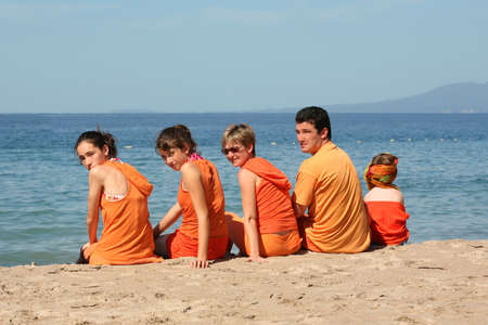 People in orange clothes on the beach